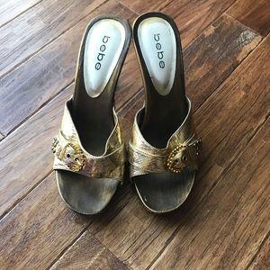 Bebe wooden gold heels